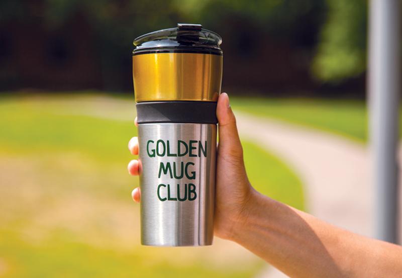 Ducks Dine On golden mug